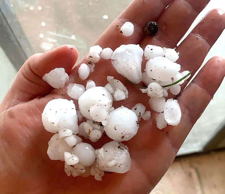 Amelia Rose collected half-inch size hail in the palm of hand in her yard in Rimrock on Friday. Courtesy of Amelia Rose