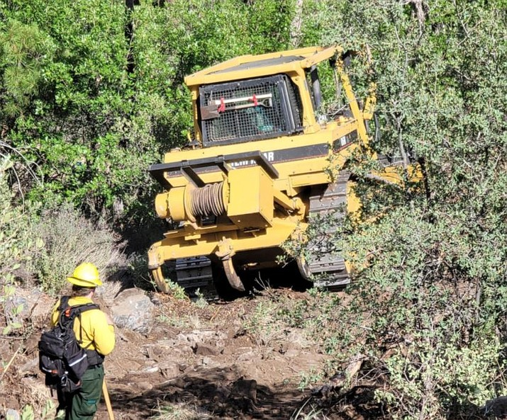 Fire crews work to construct a dozer line north of Crown King, July 9, 2021, as part of the Tiger Fire. (Inciweb)