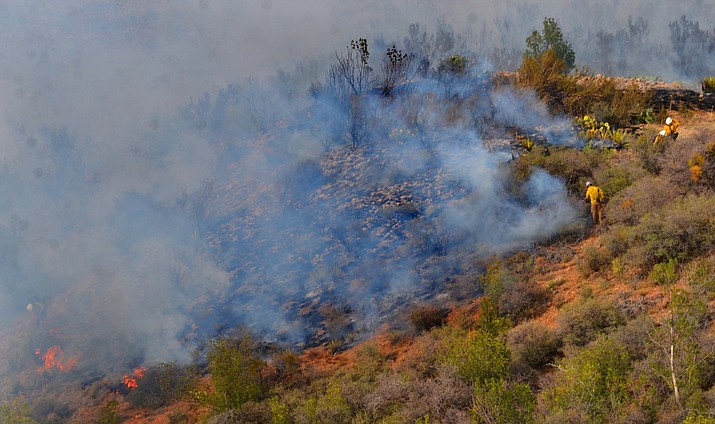 Firefighters put out a wildfire between the cement plant in Clarkdale and Jerome in the foothills. (Vyto Starinskas/VVN)