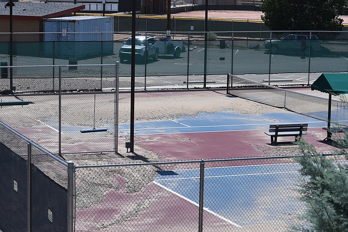 Damage to Yavapai College tennis courts on Saturday, July 9, 2021, from recent storms was apparent. (Jesse Bertel/Courier)