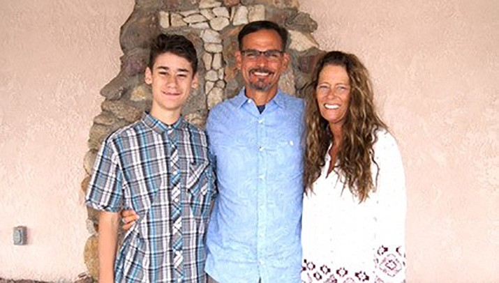 Tim Barkett, center, is the new full-time pastor at Good Shepherd Lutheran Church in Kingman. He is shown with son Josiah, left, and wife DeeDee. (Courtesy photo)