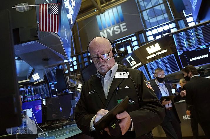 Trader John Doyle works on the floor of the New York Stock Exchange, Friday, July 16, 2021. (Richard Drew/AP)