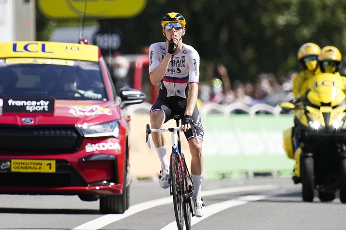 Slovenia's Matej Mohoric gestures to be quiet as he crosses the finish line to win the nineteenth stage of the Tour de France cycling race over 207 kilometers (128.6 miles) with start in Mourenx and finish in Libourne, France,Friday, July 16, 2021. Mohoric's team was subject of a police raid on Wednesday night July 14, 2021. (Christophe Ena/AP)