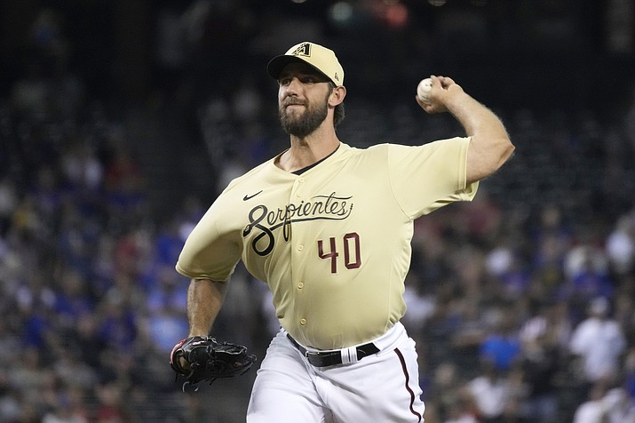 Arizona Diamondbacks pitcher Madison Bumgarner throws against the Chicago Cubs in the first inning during a baseball game, Friday, July 16, 2021, in Phoenix. (Rick Scuteri/AP)
