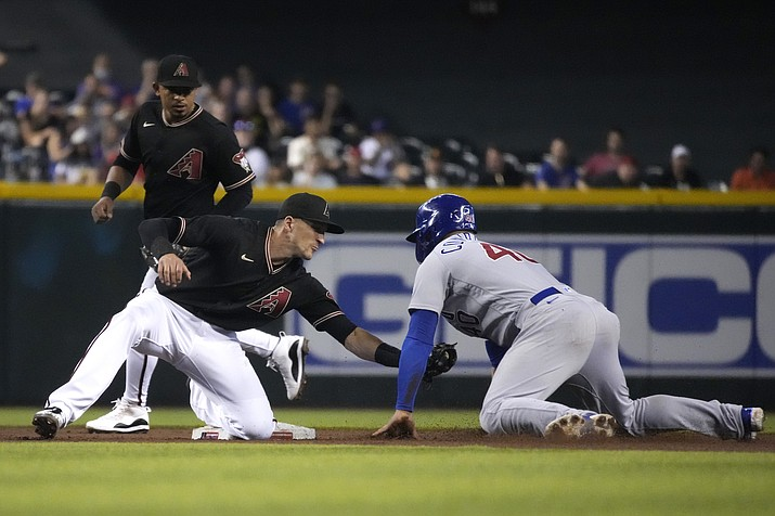Chicago Cubs' Willson Contreras (40) gets tagged out by Arizona Diamondbacks shortstop Nick Ahmed, left, while trying to steal second base in the third inning during a baseball game, Saturday, July 17, 2021, in Phoenix. (Rick Scuteri/AP)