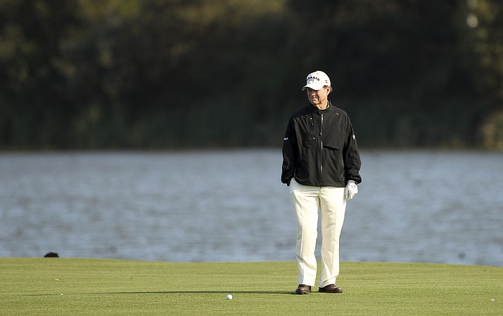 American Tom Watson stands on the 17th fairway while he waits for slow play to move along during the Australian Open golf tournament in Sydney, Australia, Thursday, Dec. 6, 2012. (Rob Griffith/AP, file)
