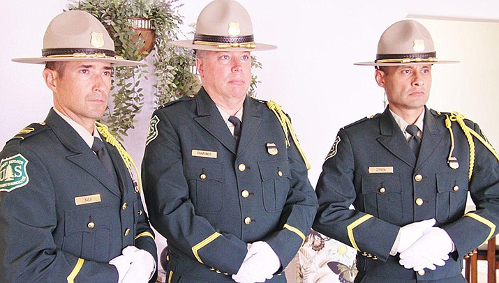 U.S. Forest Service Honor Guard members, from left, Christopher Baca, Todd Chaponot and Juan Zepeda stand watch over the bodies of two forest service firefighters this week at Bradbury Memorial Center in Lake Havasu City. (Photo by Brandon Messick/For the Miner)