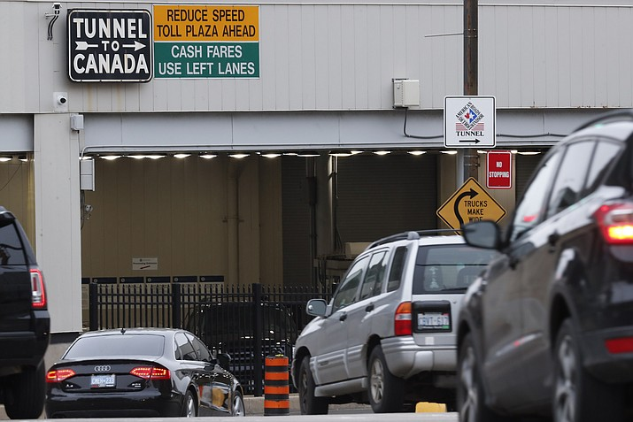 In this March 16, 2020, file photo, vehicles enter the Detroit-Windsor Tunnel in Detroit to travel to Canada. The Canada Border Services Agency has rejected a creative plan by Windsor Mayor Drew Dilkens to have Ontario residents line up inside the tunnel to get COVID-19 vaccinations. (Paul Sancya/AP, File)