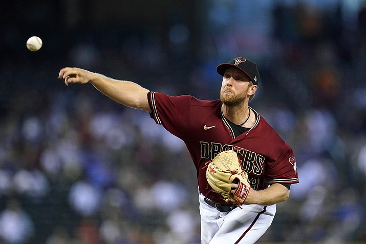Arizona Diamondbacks starting pitcher Merrill Kelly throws to a Chicago Cubs batter during the first inning of a game Sunday, July 18, 2021, in Phoenix. (Ross D. Franklin/AP)