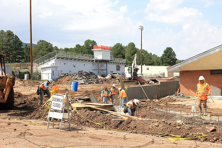 Crews work to complete the parking lot at Williams High School. (Wendy Howell/WGCN)