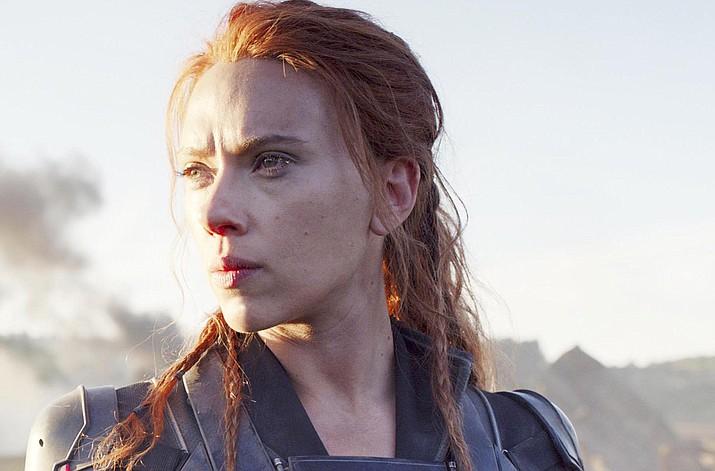 """Scarlett Johansson in a scene from """"Black Widow."""" Disney announced the film release date as July 9, 2021. (Marvel Studios/Disney via AP)"""