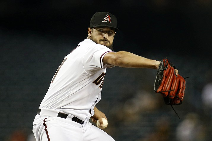 Arizona Diamondbacks pitcher Caleb Smith delivers against the Pittsburgh Pirates during the first inning of a baseball game Monday, July 19, 2021, in Phoenix. (Darryl Webb/AP)