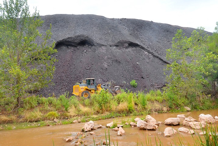 """The slide from the slag material covers a private road leading to the old power plant along the Verde River in Clarkdale on Saturday, July 17, 2021. Police are advising river users to remain """"river left"""" when approaching and travelling through the slag pile area. (Vyto Starinskas/Independent)"""