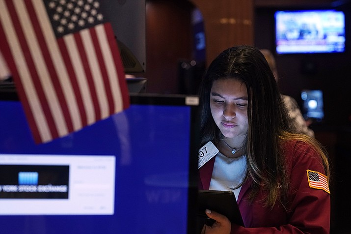 Trader Ashley Lara works on the floor of the New York Stock Exchange, Tuesday, July 20, 2021. Stocks are opening higher on Wall Street Tuesday as investors shake off a rout a day earlier brought on by concerns about the spread of a more contagious variant of COVID-19. (Richard Drew/AP)