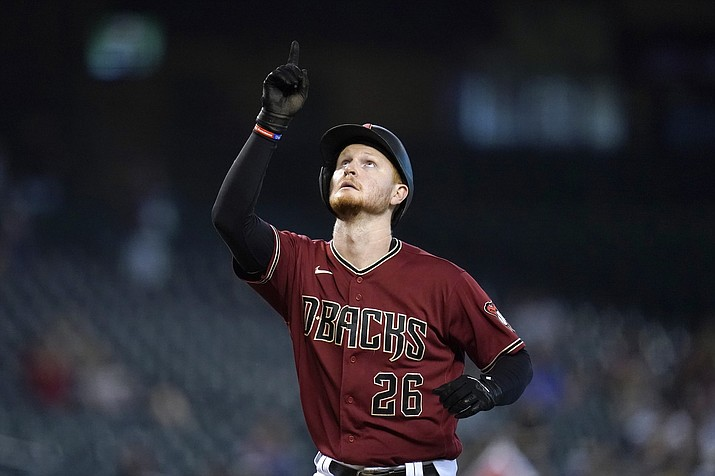 Arizona Diamondbacks' Pavin Smith points to the sky as he arrives at home plate after hitting a home run against the Pittsburgh Pirates during the seventh inning of a game Wednesday, July 21, 2021, in Phoenix. The D-backs defeated the Pirates 6-4. (Ross D. Franklin/AP)