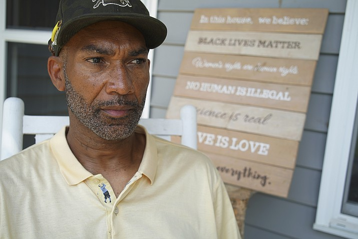 Alton Lucas sits on the porch of his home outside of Raleigh, N.C., on Friday, June 18, 2021. As a teenager, Alton Lucas believed basketball or music would pluck him out of North Carolina and take him around the world. In the late 1980s, he was already the right-hand man to his musically inclined best friend, Youtha Anthony Fowler, who many hip hop and R&B heads know today as DJ Nabs. (Allen G. Breed/AP)