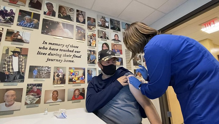 Public health officials are urging Arizonans to get vaccinated against COVID-19 because new cases are rising again. Here, a homeless man in Phoenix receives his first vaccine dose in January. (Circle the City/Courtesy via Cronkite News)