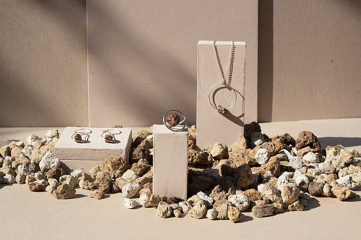 In this image provided by Vikur/Agusta Arnardottir, Vikur Studio, founded by artist Agusta Arnarsdottir, offers modern jewelry crafted from pumice found on lava fields around Iceland. (Britt Berden/Vikur/Agusta Arnardottir via AP)