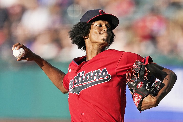 Cleveland Indians starting pitcher Triston McKenzie delivers in the first inning of a baseball game against the Kansas City Royals July 9, 2021, in Cleveland. (AP Photo/Tony Dejak)