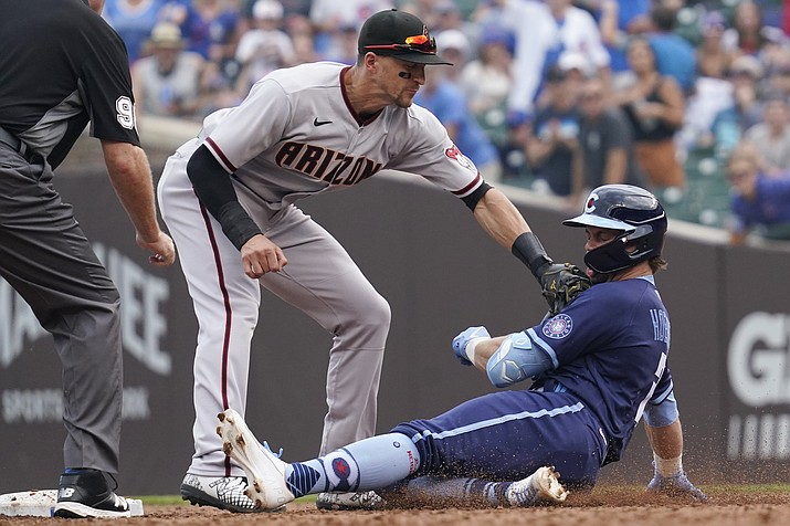 Arizona Diamondbacks shortstop Nick Ahmed tags out Chicago Cubs' Nico Hoerner, right, at second base after Hoerner hit a two-run single during the third inning of a baseball game in Chicago, Friday, July 23, 2021. (Nam Y. Huh/AP)