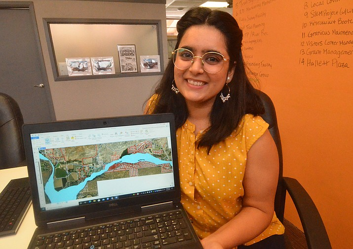 Farwa Hussain shows one of the maps she designed during her internship in the Economic Development department with Steve Ayers on Thursday, July 22, 2021. (Vyto Starinskas/Independent)