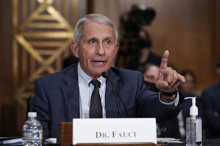 Top infectious disease expert Dr. Anthony Fauci responds to accusations by Sen. Rand Paul, R-Ky., as he testifies before the Senate Health, Education, Labor, and Pensions Committee, on Capitol Hill in Washington, Tuesday, July 20, 2021. Cases of COVID-19 have tripled over the past three weeks, and hospitalizations and deaths are rising among unvaccinated people. (J. Scott Applewhite/AP, Pool)