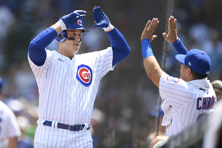 Chicago Cubs' Anthony Rizzo left, celebrates at the dugout with teammate Robinson Chirinos right, after hitting a solo home run during the first inning of a baseball game against the Arizona Diamondbacks Sunday, July 25, 2021, in Chicago. (Paul Beaty/AP)