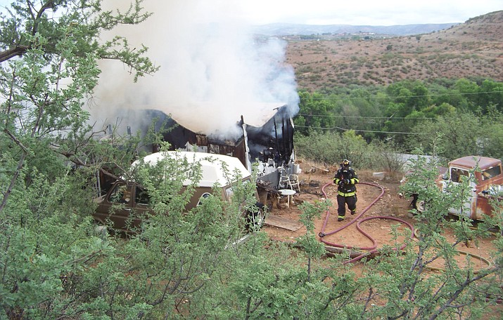 Verde Valley Fire District personnel were called to a house fire about 10 a.m. Saturday, July 24, 2021, at South Kadamoto Drive in Cornville. Fire officials discovered a body within the rubble, and the Yavapai County Sheriff's Office has taken over the investigation. (Vyto Starinskas/Independent)