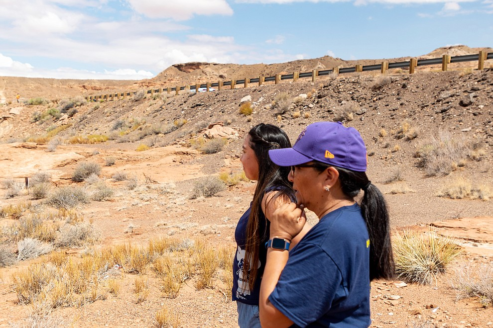Former Miss Hopi Mikaela Gamble along with her mother Shelly Hongeva watch the flooding with concern from a cliff side vantage point July 25. (Gilbert Honanie/NHO)