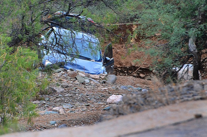 Search teams have fanned out from this vehicle in a wash just off Camino Real in the Verde Valley, as they look for a 16-year-old girl who was swept away in a flood Saturday night, July 24, 2021. (Vyto Starinskas/Verde News)