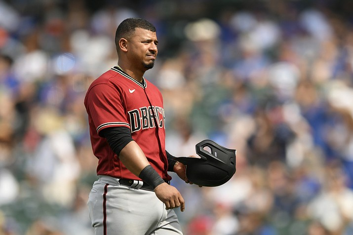 Arizona D-backs' reacts after being tagged out at second base during the eighth inning of a game against the Chicago Cubs, Sunday, July 25, 2021, in Chicago. (Paul Beaty/AP)