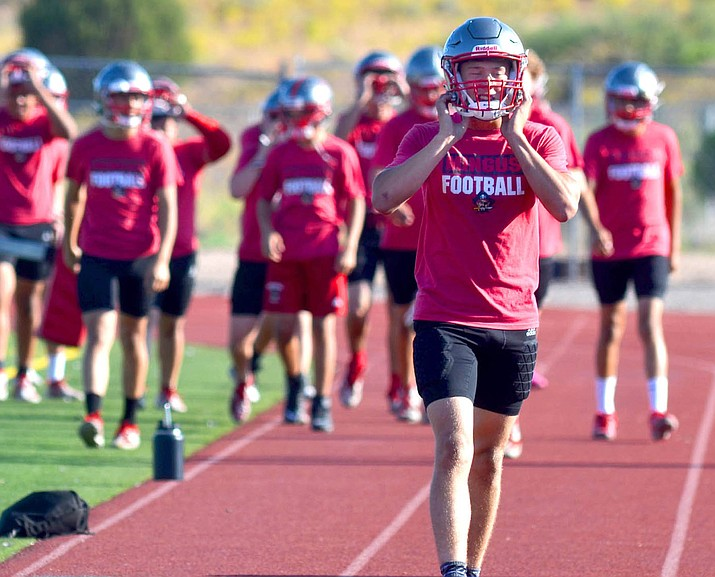 In this September 2020 file photo, players for the Mingus football team warm up. The Arizona Interscholastic Association issued recommended guidelines Monday, July 26, 2021, for returning to athletic activity this school year, including a call for those involved in athletics to get a COVID-19 vaccine. (Independent file photo)