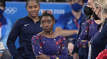 Olympics Roundup: Biles tries to lead Team USA to third consecutive gold medal photo