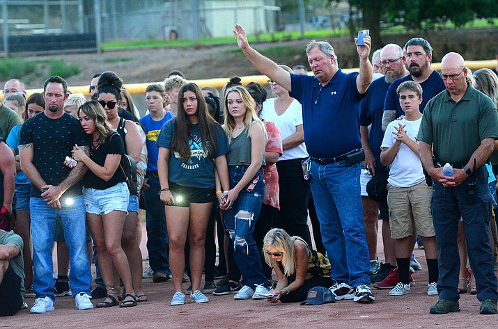 Hundreds of people turned out from the community on Monday, July 26, 2021, to join family members for a prayer vigil for Faith Moore, the 16-year-old who was swept away in the flood on Saturday night, July 24. (Vyto Starinskas/Independent)