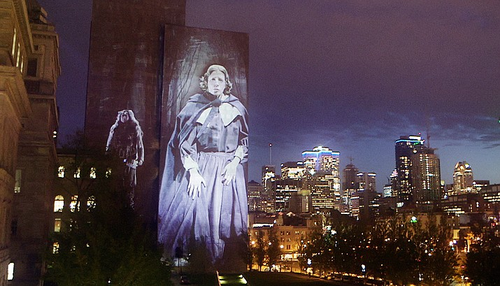 """Joyful, magical, inspiring, """"Into the Light"""" with Cité Mémoire soars above the city, revealing history through giant projections that compel us to slow down, look up and breathe as characters of the past emerge from the stone walls of Old Montreal, touching us deeply with their human stories."""