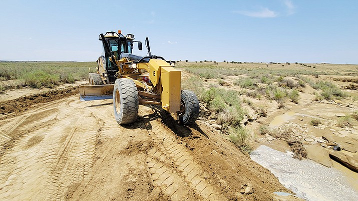 Repairs continue along Navajo Route 91 after monsoon rains July 25. (Photos/Office of the Navajo President)