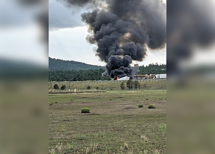 A tractor trailer is fully engulfed July 25 during an accident on Interstate 40 in Williams at Exit 163. (Photo/Garret Woodknocker)