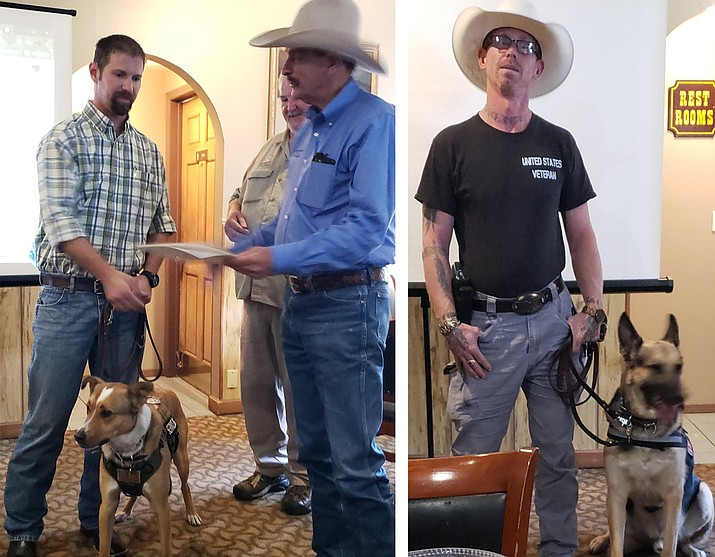 Two participants and their dogs receive certificates of completion for the first phase of their training July 23 in Williams. (Submitted photo)