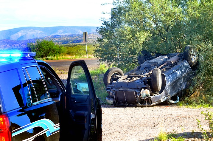 An SUV lies on its roof after a suspected hit-and-run caused the rollover accident near the intersection of Cornville Road and State Route 89A around 7:30 a.m. Friday, July 30, 2021. 730 a.m. (Vyto Starinskas/Independent)