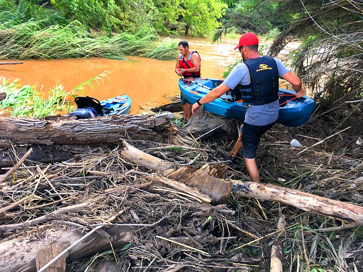 Michael Wadsworth, no shirt, Brandon Anderson, red hat, search for Faith Moore in the Verde River mud on Tuesday, July 27, 2021. Vyto Starinskas/Verde Independent