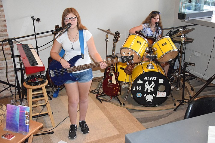 Tivona Moskoff, left, and her sister, Gracie on drums, have been playing live music in the Verde Valley and elsewhere in Arizona the past couple of years. Tivona, age 12, and Gracie, 15, play classic rock, country, folk and pop songs that cover more than 50 years. (Jason W. Brooks/Kudos)