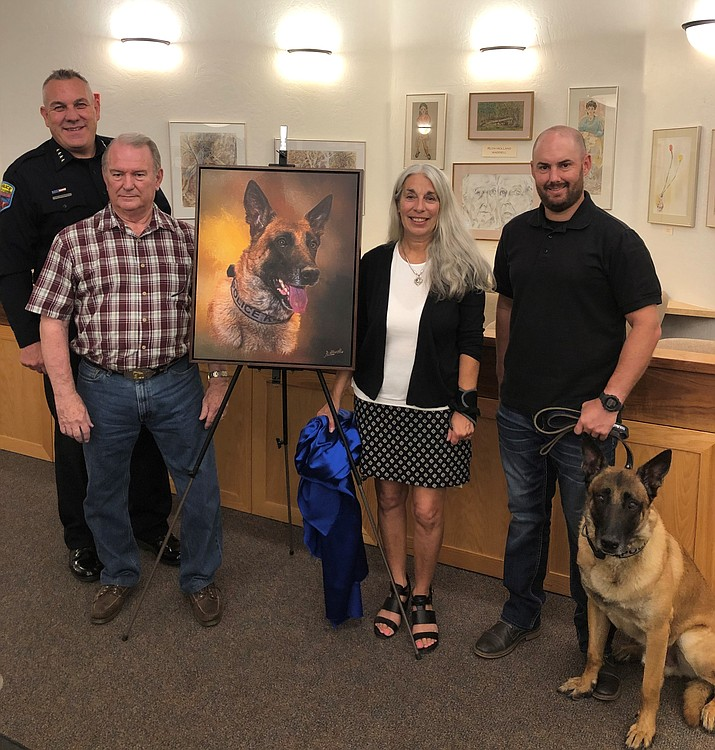 Chief Charles Husted,Robert Albrecht,City of Sedona Arts and Culture Coordinator Nancy Lattanzi, andHandler Officer Jonathan Reed with Max. (City of Sedona/Courtesy)