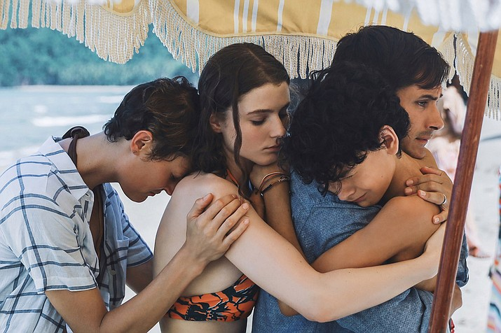 """This image released by Universal Pictures shows, from left, Vicky Krieps, Thomasin McKenzie, Gael García Bernal and Luca Faustino Rodriguez in a scene from """"Old."""" (Universal Pictures via AP)"""