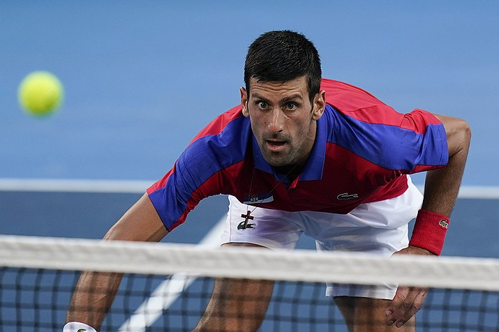 Novak Djokovic, of Serbia, returns a shot to Pablo Carreno Busta, of Spain, during the bronze medal match of the tennis competition at the 2020 Summer Olympics, Saturday, July 31, 2021, in Tokyo, Japan. (Seth Wenig/AP)
