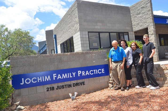 Dr. Robert Jochim, Cathleen Jochim-Malapanes, MSN FNP-BC, Mayra Nieblas, Waylon Wright pose for a photo in front of the new Jochim Family Practice at 218 Justin Drive in Cottonwood. (Vyto Starinskas/Independent)