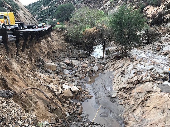 This photo provided by the Arizona Department of Transportation shows flood damage along US 60 west of Miami, Ariz.  Aug. 11. Forecasters warned that runoff from wildfire burn scars could trigger mudslides and produce flows carrying debris through normally dry washes. (Arizona Department of Transportation via AP)