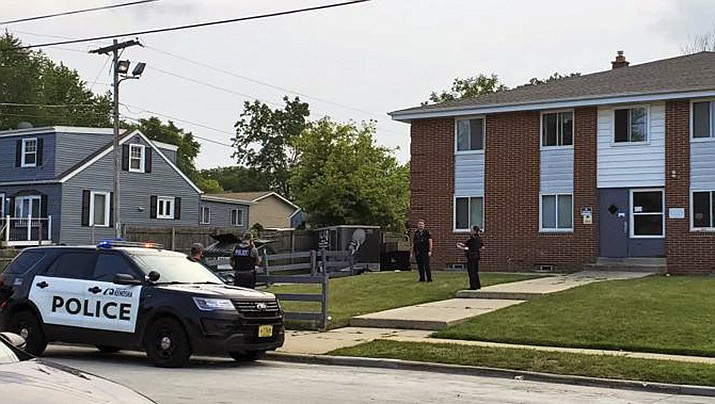 Kenosha Police investigate a shooting at 40th Avenue and 45th Street on the city's north side Tuesday, Aug. 10, 2021, in Kenosha, Wisc. A 19-year-old woman was using a handgun's laser sight as a cat toy when she accidentally shot a friend, according to prosecutors. (Terry Flores/The Kenosha News via AP)