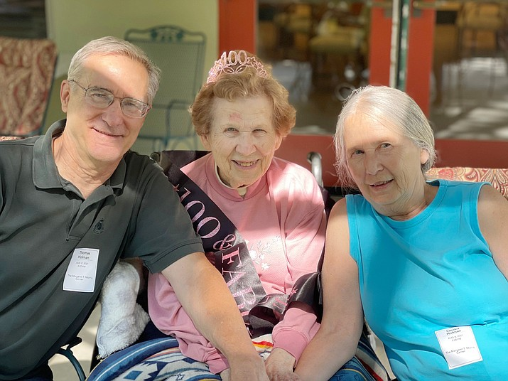 Ruth Holman celebrated her 100th birthday on Sunday, Aug. 8, 2021. Pictured with Ruth, center, are her children, Thomas and Sandra. (Courtesy)