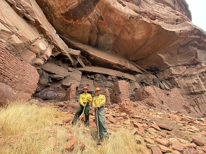 U.S. Forest Service resource specialists Michael Terlep and Jason Nez evaluate fuel loads during the Rafael Fire to determine the best methods of mitigating fire damage to prehistoric structures and rock art at the Honanki and Palatki sites on Coconino National Forest. (Photo/USFS)