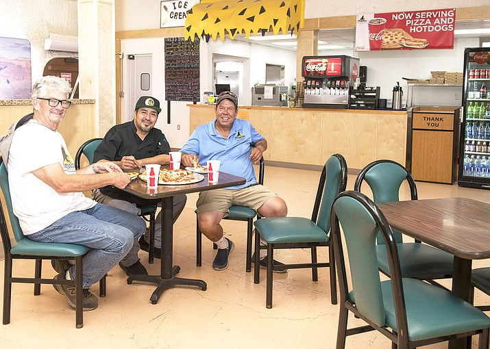 Fred's Diner at Raptor Ranch welcomes guests from around the world. From left: Raptor Ranch, co-owner, Ron Brown, head chef Francisco Granados and Raptor Ranch co-owner Troy Morris. (V. Ronnie Tierney/WGCN)